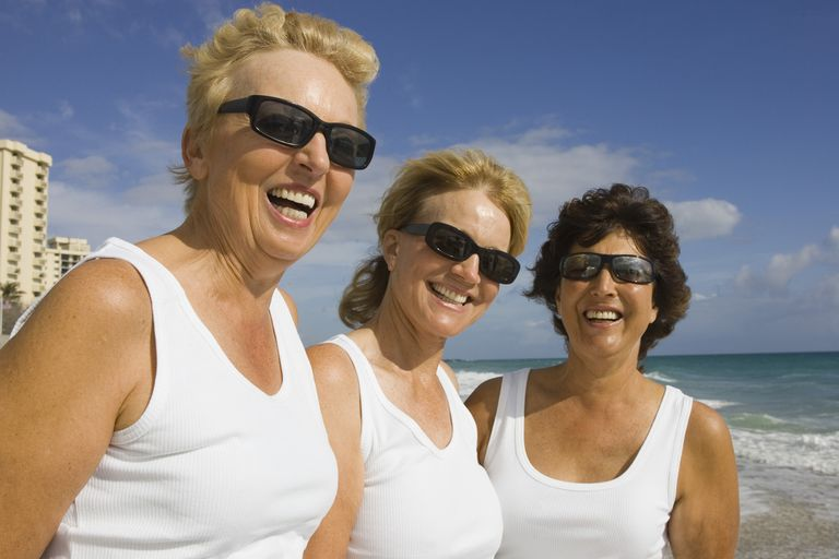 Senior women with sunglasses who all have a long life expectancy.