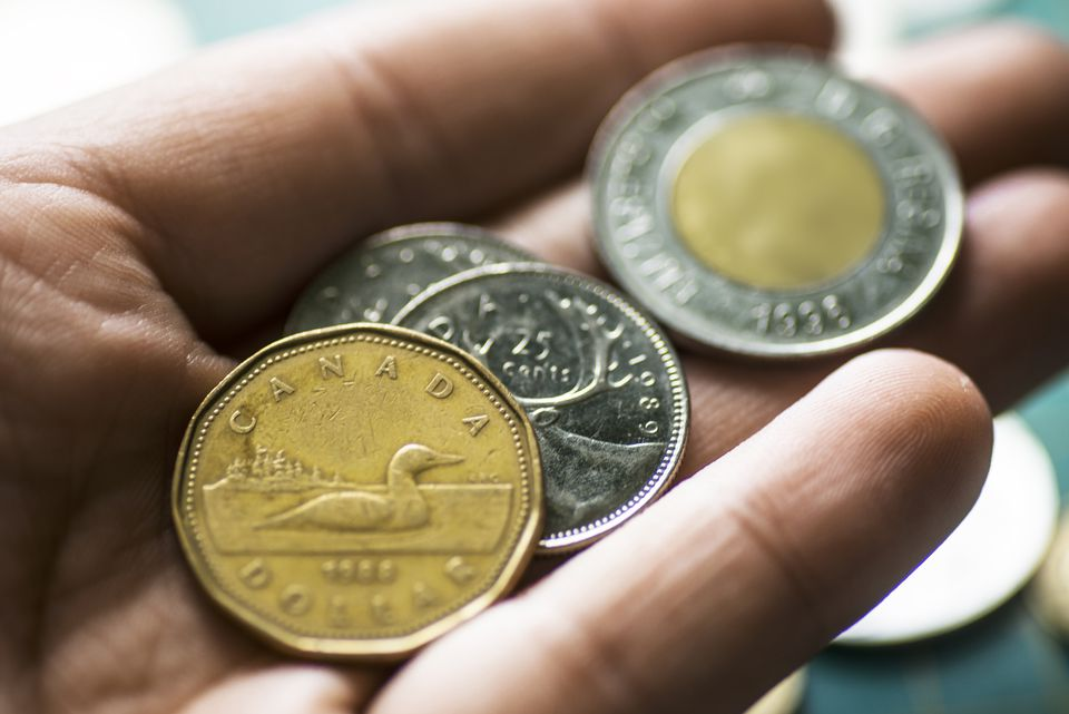Canadian currency in hand