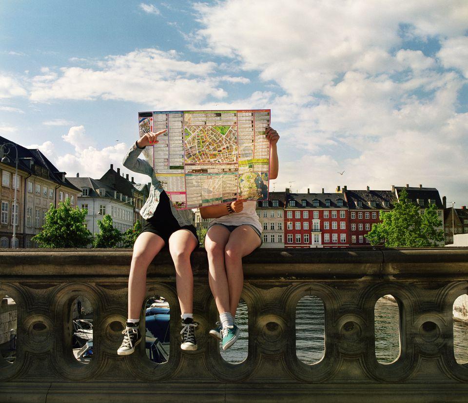 Teenager hidden by city map