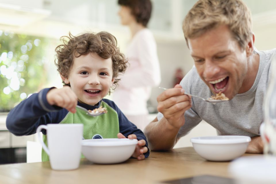 Father and son eating cereal