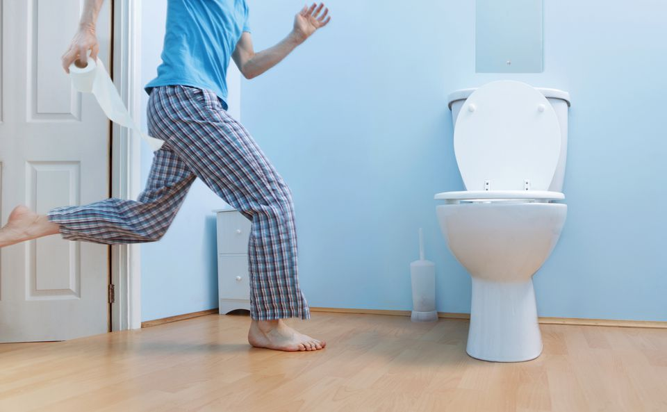 Man running to the toilet