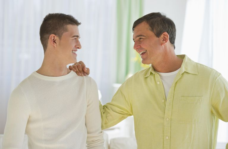 USA, New Jersey, Jersey City, Father and son (16-17) talking