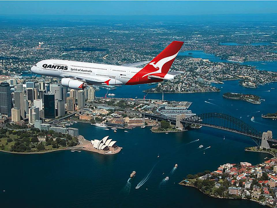 A Qantas plane flies over Sydney