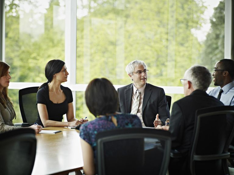 Coworkers in planning meeting in conference room