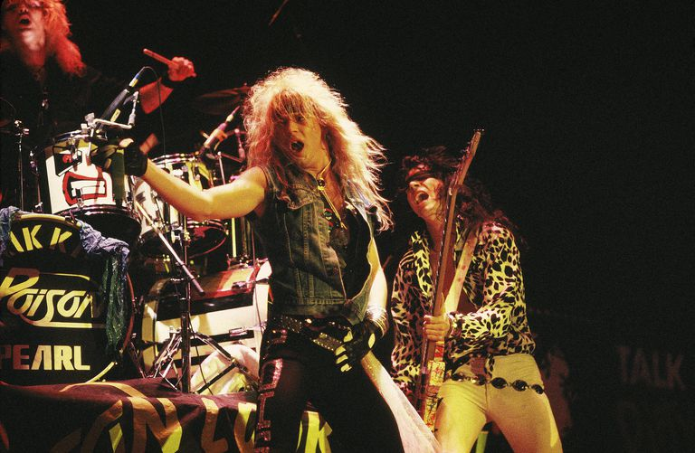 Drummer Rikki Rocket, lead vocalist Bret Michaels (left) and bassist Bobby Dall of Poison perform on stage in 1987.