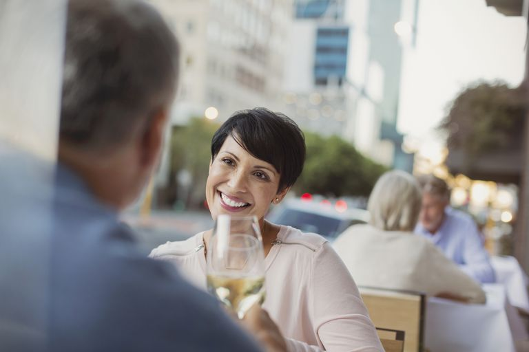 Mature woman smiling on a date with a man