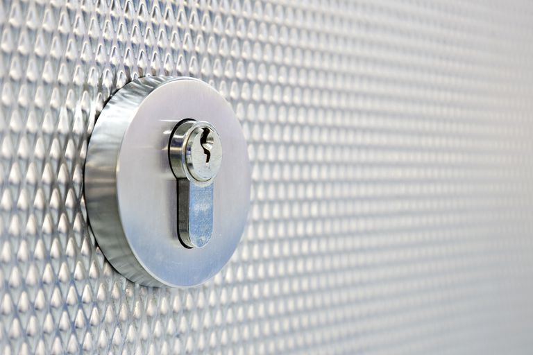 silver lock on silver wall