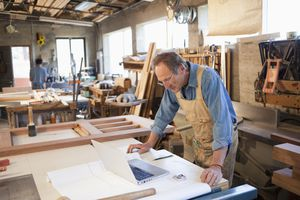 Caucasian carpenter working in workshop