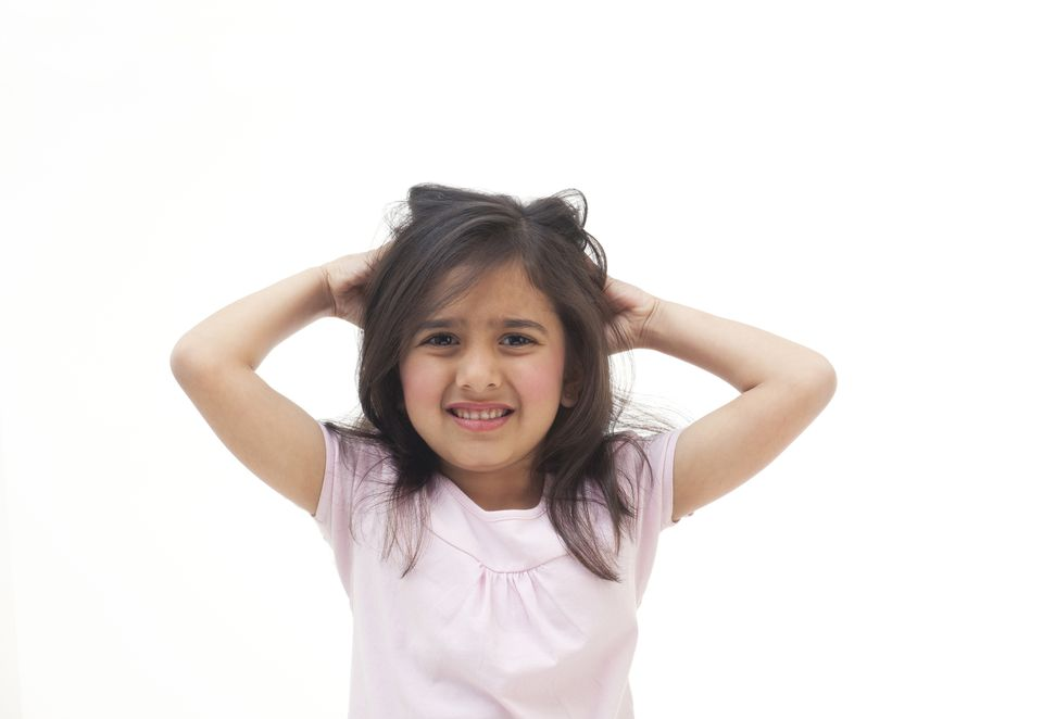 Young girl scratching her head