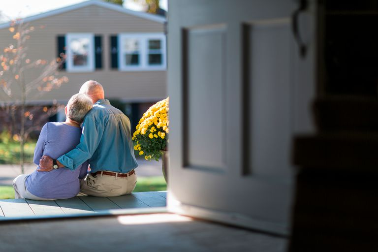 Seniors hugging on front porch