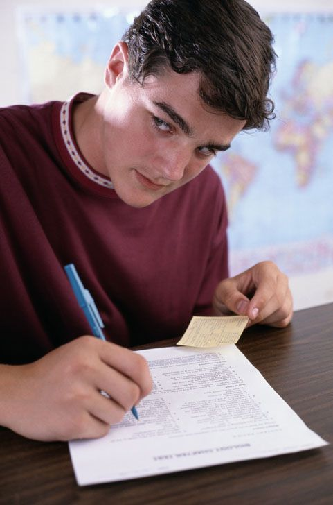 Boy Cheating on a Test in a Classroom