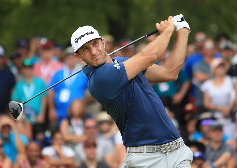 Dustin Johnson tees off during the Canadian Open tournament