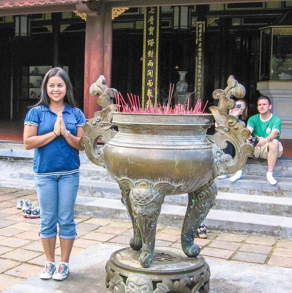 Tourist posing in Thien Mu Pagoda, Hue, Vietnam