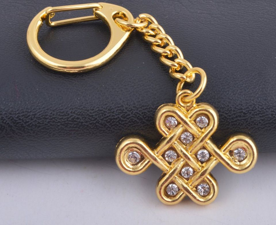 Mystic knot feng shui symbol meaning and use mystic knot golden keychain feng shui good luck amulet mozeypictures Image collections