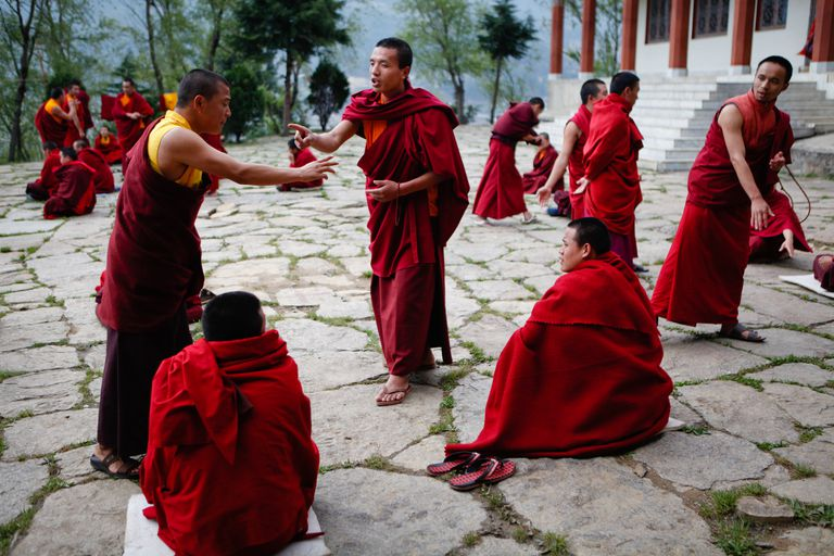 Young buddhist monks at a monastery in Bumthang, central Bhutan, debate what they have learned during their monastic studies.