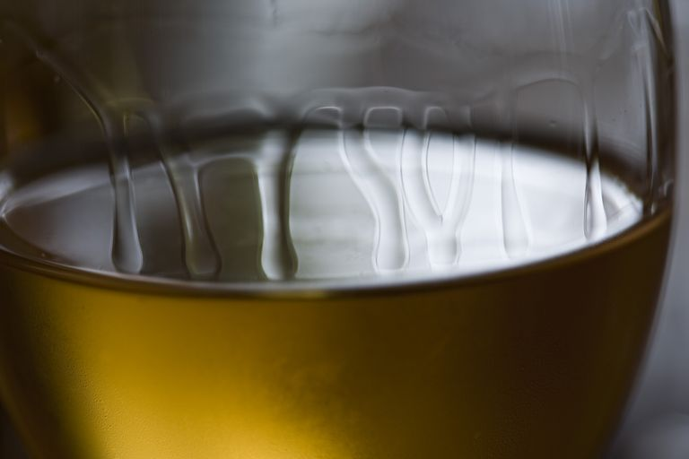 Here are tears of wine on a glass of white wine.
