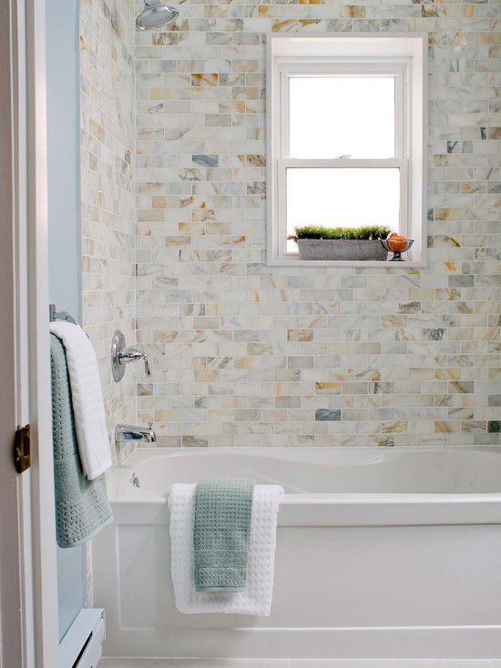 Bathroom With Variegated Marble Subway Tile