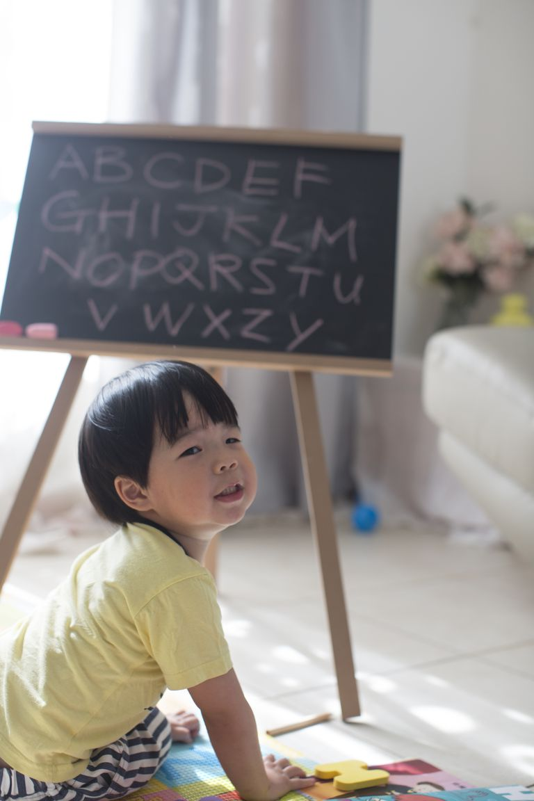Asian toddler boy learning alphabets.