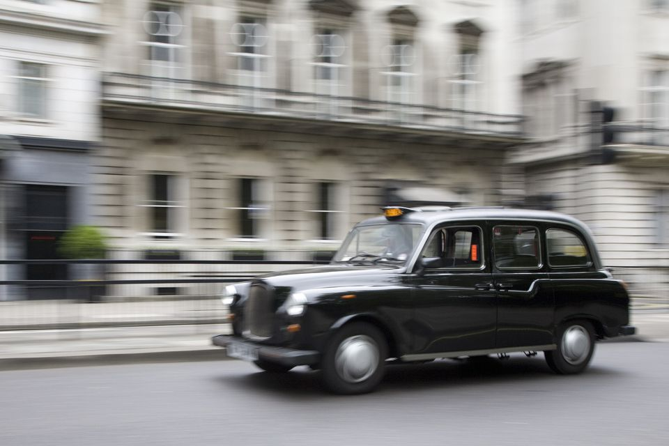 Motion blur, black London taxi cab