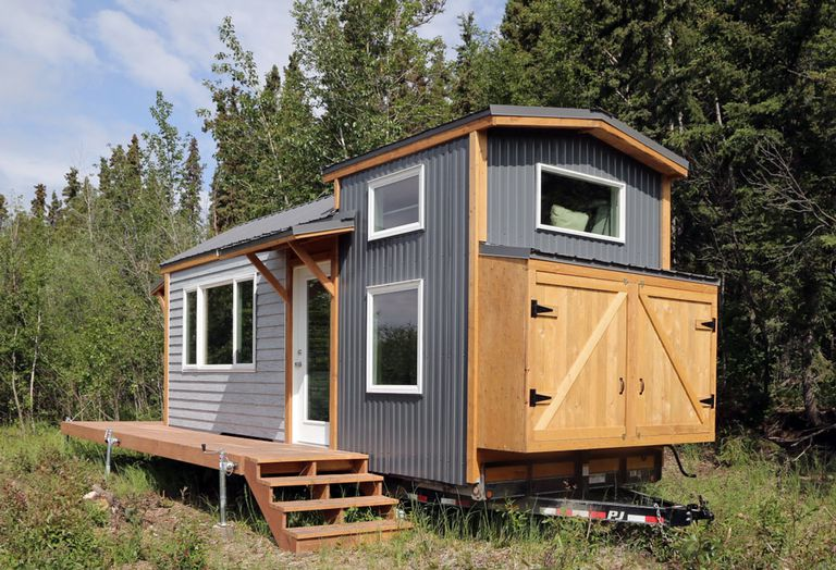 A modern rustic tiny house in the woods