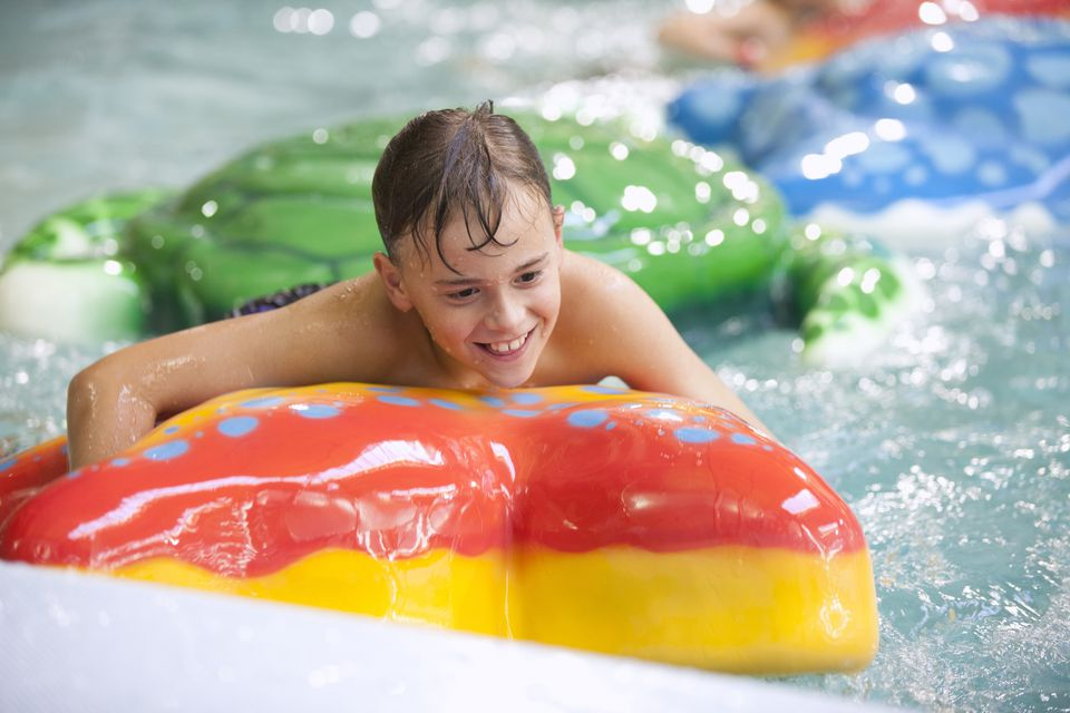 Young boy playing at the indoor waterpark