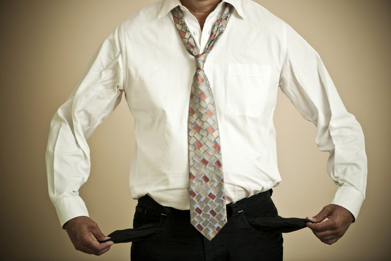 man holding out empty pants pockets