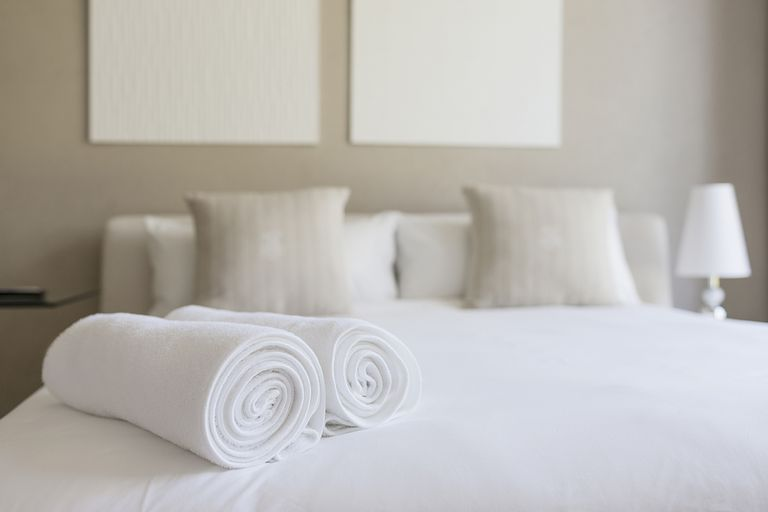 Towels on bed in bedroom