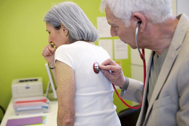 Doctor examining elderly woman