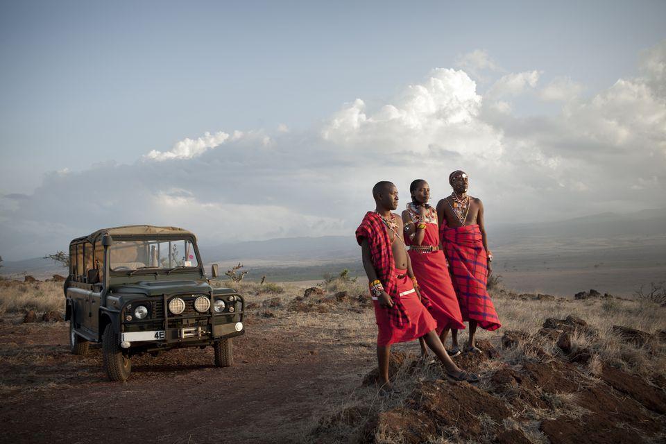 Three Maasai safari guides stand for a portrait in Laikipia, Kenya.