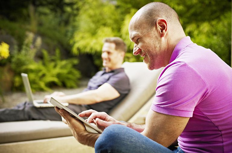 couple sitting on patio of home