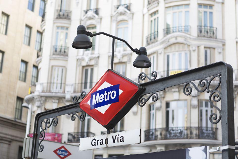 Metro signpost along Grand Via, Madrid.
