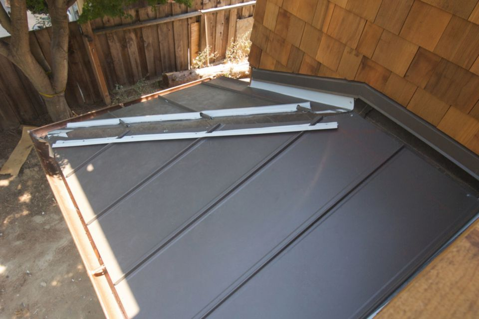 Standing Seam Steel Roof Being Installed 1500 x 1000