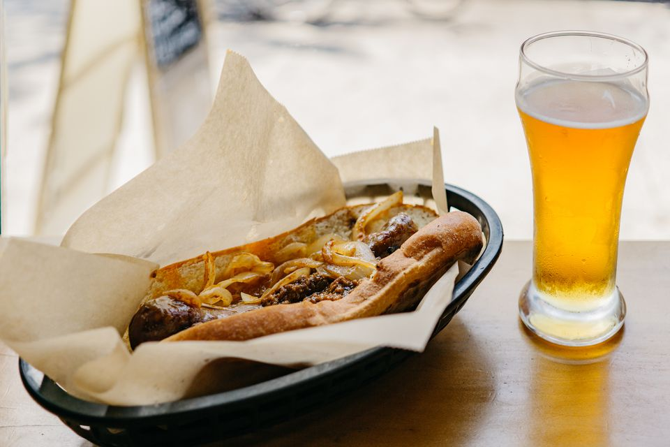 Beer and caramelized onions on bratwurst