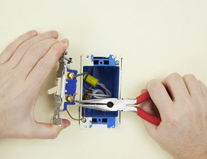 Lightswitchrepair-GettyImages-173626342-5917e0795f9b586470054c54 Upgrade A Fuse Box To Circuit Breakers on fuse box to breaker box, fuse type circuit breakers, fuse box cables, fuse box diode, fuse box wiring, fuse box conduit,