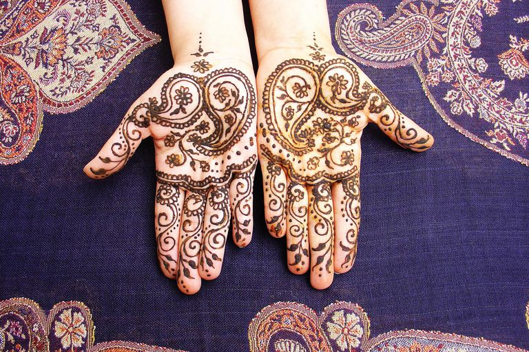 Henna tattoos on open hands