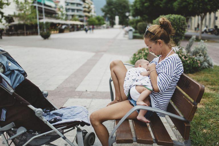 Mother breastfeeding her baby outdoor