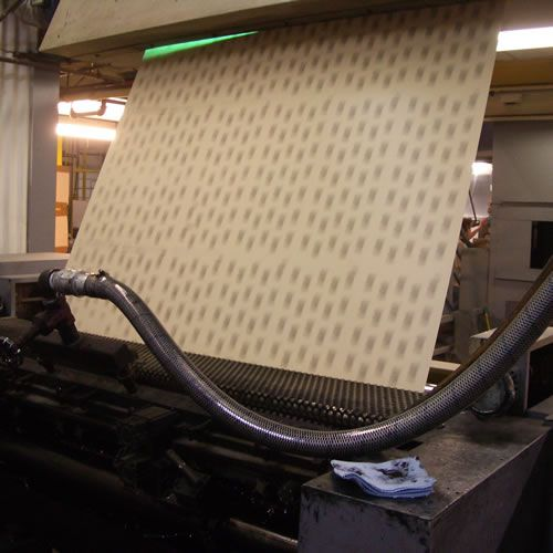 Printing the grit size and type on the back of sandpaper