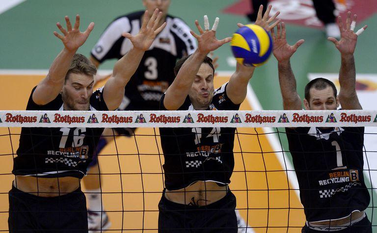 Volleyball players blocking