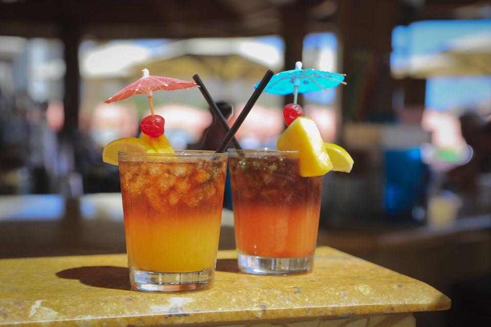 Two Mai Tais serves on a beach in Hawaii