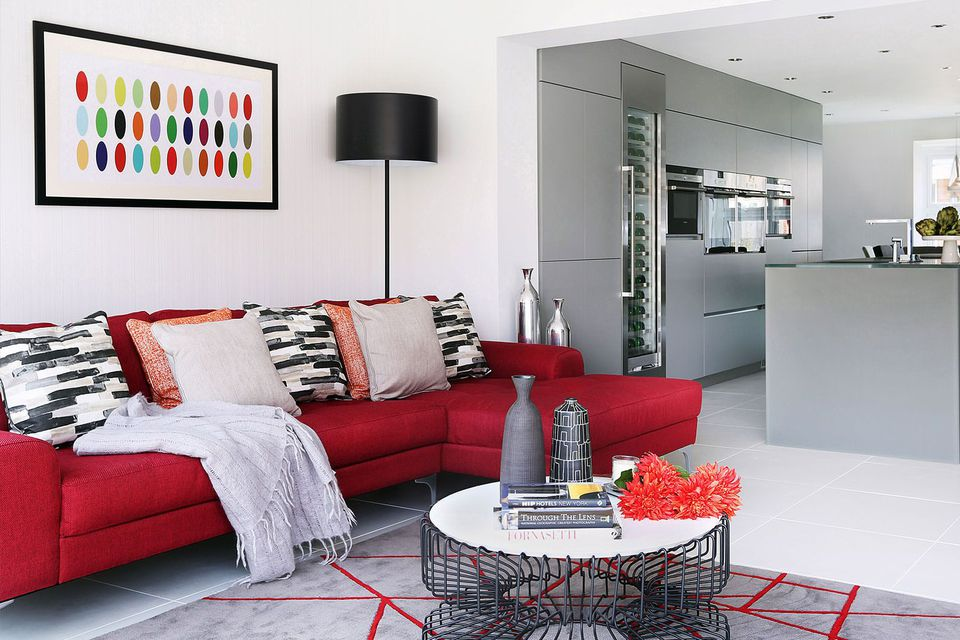 Crimson sofa gray kitchen