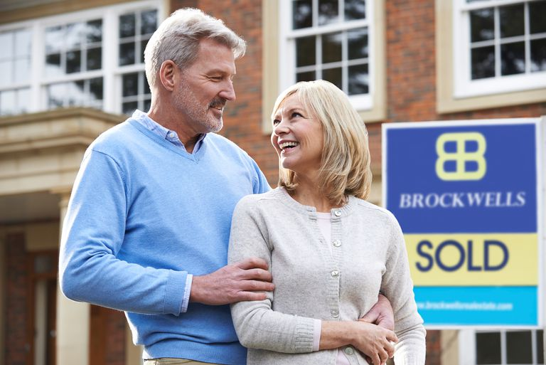 Couple excited they sold a white elephant house