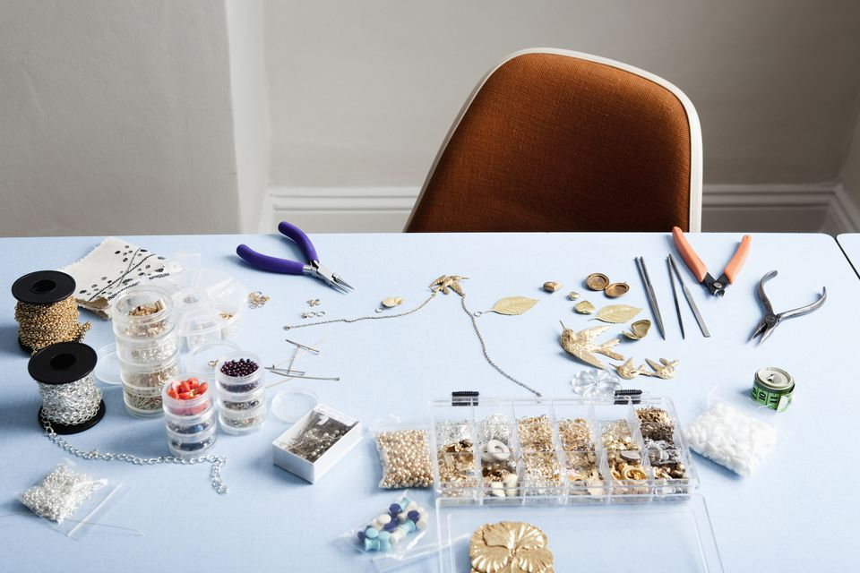 Image of jewelry on a craft table