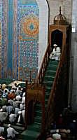 Islamic worshippers listen to the Imam preach from the Minbar in Almaty, Kazakhstan.