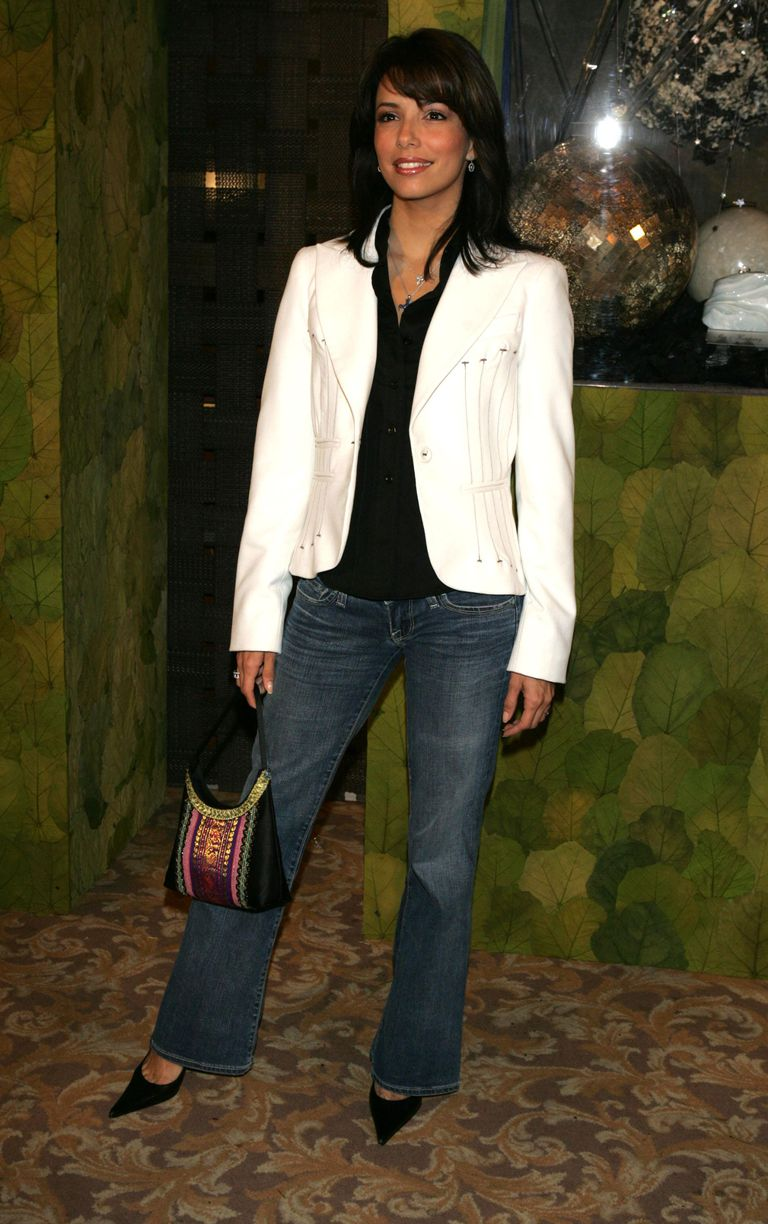 Eva Longoria wears a white single-breasted jacket with vertical seaming detail.