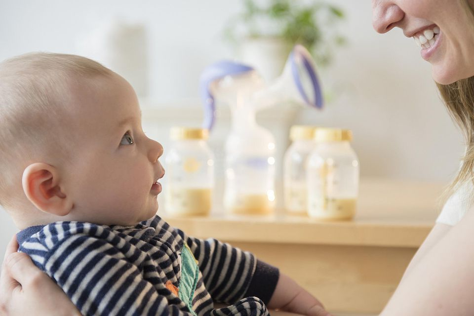 Mom and baby with breast pump