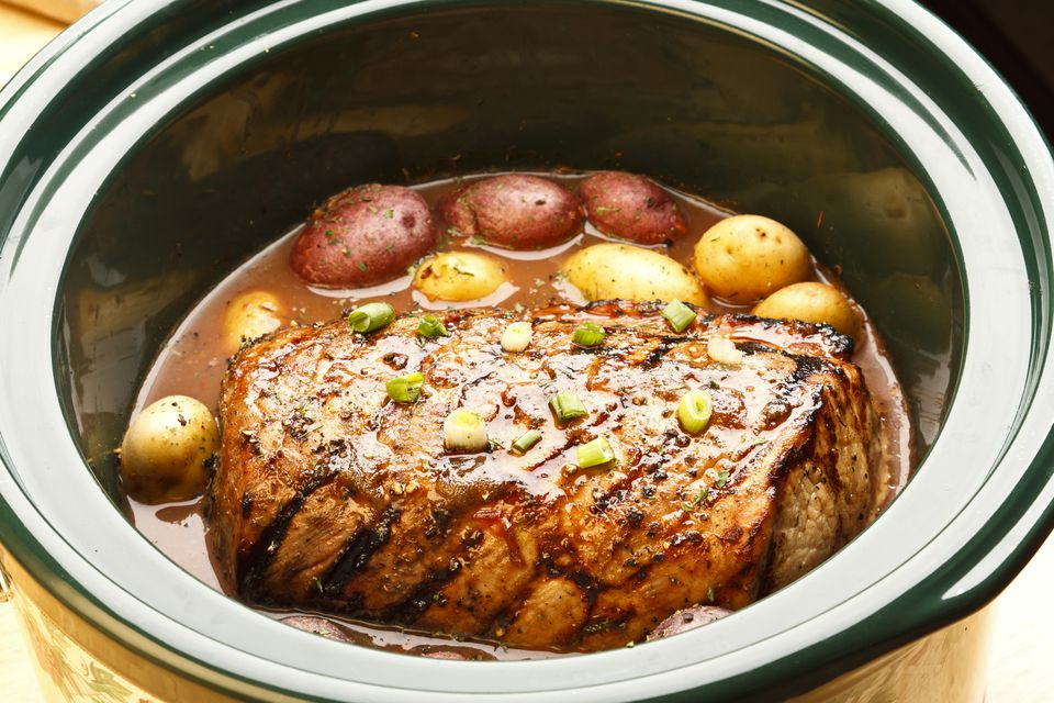 Pot roast cooking in crock pot