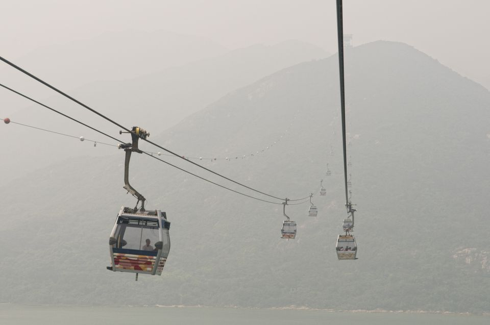 The Ngong Ping cable car shrouded in haze that takes tourists to the Great Buddha and the Polin Monastery on Lantau Island Hong Kong.
