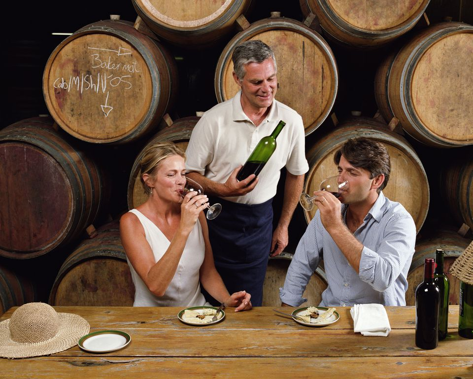 Couple enjoying a wine tasting.