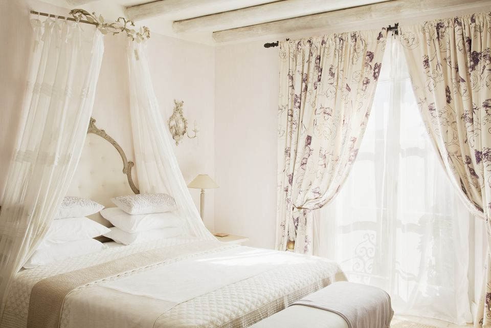Bed with canopy in luxury bedroom