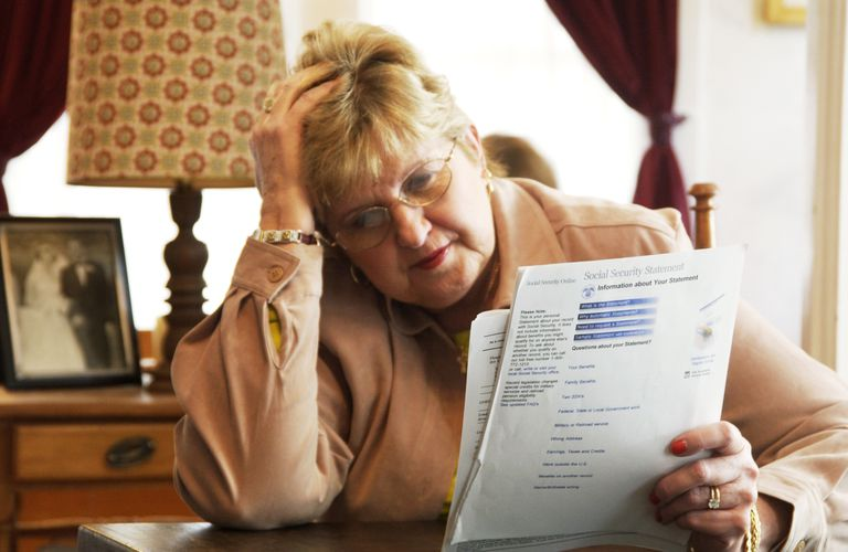 Woman looking at Social Security paperwork